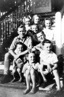 The Healy crew at home on the front steps at 27 Miles Street Wooloowin. Back row L-R Carmel, Kathleen, Paddy (Patricia) Middle row Vince, Geraldine Jim, Front Row Peter Marie John. Picture taken pre-1946 before Monica was born.